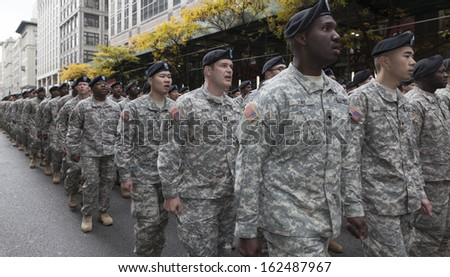 NEW YORK - NOVEMBER 11: Atmosphere during the 94th annual New York City Veterans Day Parade on 5th Avenue on November 11, 2013 in New York City