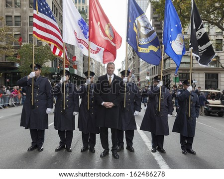 NEW YORK - NOVEMBER 11: Bill de Blasio marches with police officers of Port Authority at the 94th annual New York City Veterans Day Parade on 5th Avenue on November 11, 2013 in New York City - stock photo