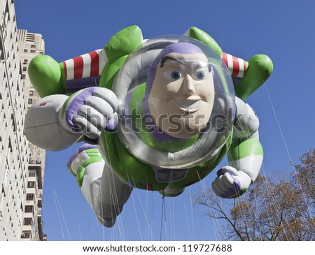 NEW YORK - NOVEMBER 22: Buzz Lightyear balloon is flown at the 86th Annual Macy's Thanksgiving Day Parade on November 22, 2012 in New York City.