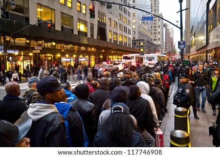 NEW YORK - NOVEMBER 2:  Commuters wait in long lines for Bus service around Grand Central post Hurricane Sandy November 2, 2012 in New York City.
