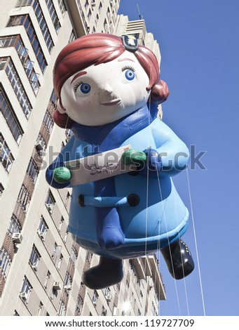 NEW YORK - NOVEMBER 22: Editor of the New York Sun newspaper balloon is flown at the 86th Annual Macy's Thanksgiving Day Parade on November 22, 2012 in New York City.