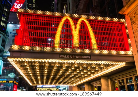 """NEW YORK - NOVEMBER 22, 2013. illuminated neon sign with the world famous """"M"""" representing McDonalds along 42nd street in Times Square. The company was founded in 1940 in San Bernardino, California."""