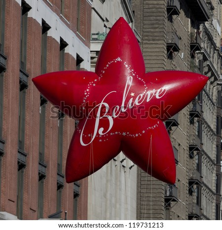 NEW YORK - NOVEMBER 22: Macy's star balloon is flown at the 86th Annual Macy's Thanksgiving Day Parade on November 22, 2012 in New York City.