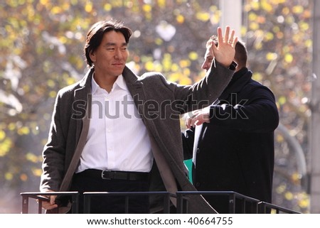 NEW YORK - NOVEMBER 6: Matsui Hideki waving his hands to Yankee Fans during the ticket-tape parade on November 6, 2009 in New York, NY. - stock photo