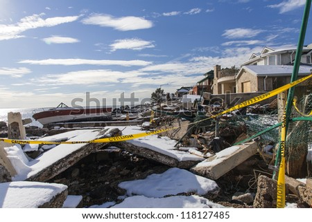 NEW YORK - NOVEMBER 8, 2012:Pile of debris and boat near flooded and damaged houses after Hurricane Sandy  on Manhattan Beach on November 8, 2012, Brooklyn, NY