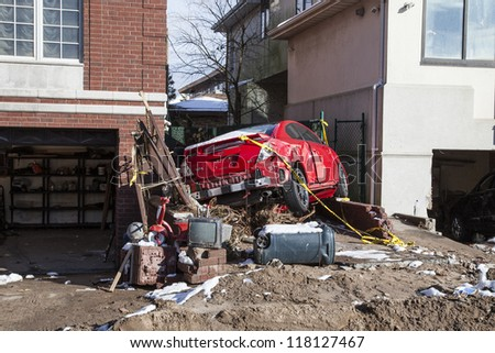 NEW YORK - NOVEMBER 8, 2012:Pile of garbage, debris, car and household items near flooded and damaged house after Hurricane Sandy  on Manhattan Beach on November 8, 2012, Brooklyn, NY