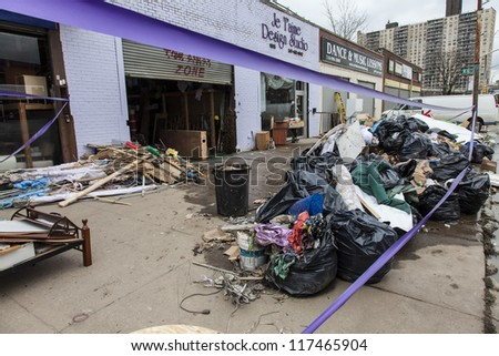 NEW YORK - NOVEMBER 1, 2012: Piles of garbage and debris caused by Hurricane Sandy  in Brooklyn NY, near flooded businesses on Surf Avenue on November 1, 2012, Brooklyn, NY