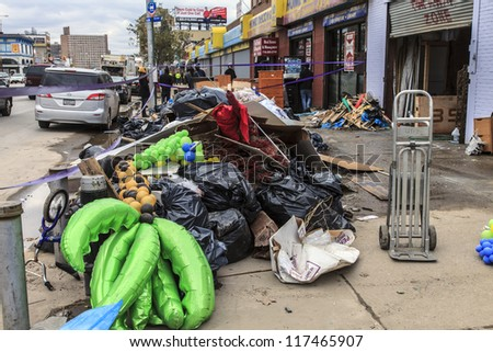 NEW YORK - NOVEMBER 1, 2012: Piles of garbage and debris caused by Hurricane Sandy  in Brooklyn NY, near flooded businesses on Surf Avenue on November 1, 2012, Brooklyn, NY - stock photo