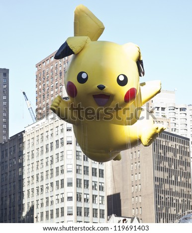 NEW YORK - NOVEMBER 22: Pokemon balloon is flown at the 86th Annual Macy's Thanksgiving Day Parade on November 22, 2012 in New York City.