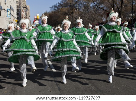 NEW YORK - NOVEMBER 22: Tap dancing Christmas trees perform at the 86th Annual Macy's Thanksgiving Day Parade on November 22, 2012 in New York City.