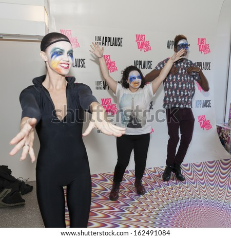 NEW YORK - NOVEMBER 11: Unidentified fans dance at xBox video game of Lady Gaga during Artpop Pop Up: A Lady Gaga Gallery in Meatpacking District on November 11, 2013 in New York City