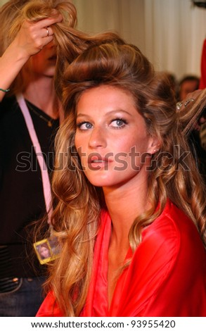 NEW YORK - NOVEMBER 9: Victoria's Secret Fashion model Gisele Bundchen getting ready backstage during the 2010 Victoria's Secret Fashion Show on November 9, 2005 at the Lexington Armory in New York