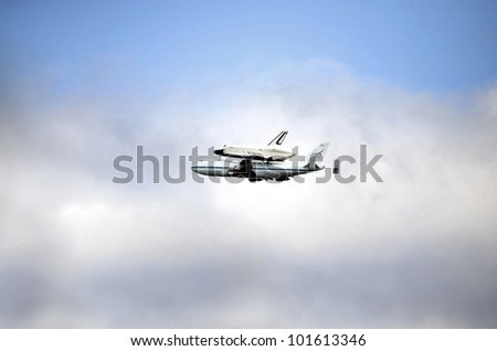 NEW YORK, NY - APRIL 27:  The Space Shuttle Enterprise rides on top of a jumbo 747 airplane. Photographed as the aircraft flew over Manhattan on their way to JFK airport. Taken April 27, 2012 in NYC.