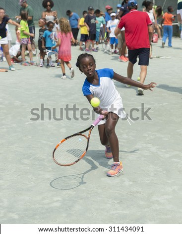 New York, NY - August 30, 2015: Chantajah Mills of Harlem participate in annual Central Park tennis clinic with professional players of US Open Championship sponsored by Lacoste