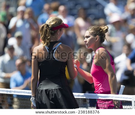 NEW YORK, NY - AUGUST 25: Danielle Rose Collins of USA & Simona Halep of Romania greet each other after 1st round match at US Open tennis tournament in Flushing Meadows USTA Tennis Center 2014