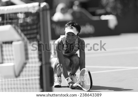 NEW YORK, NY - AUGUST 25: Kimiko Date-Krumm of Japan reacts during 1st round match against Venus Williams of USA at US Open tennis tournament in Flushing Meadows USTA Tennis Center 2014