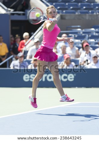 NEW YORK, NY - AUGUST 25: Simona Halep of Romania returns ball during 1st round match against Danielle Rose Collins of USA at US Open tennis tournament in Flushing Meadows USTA Tennis Center 2014