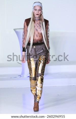 NEW YORK, NY - FEBRUARY 13: A model walks at Nina Athanasiou Runway at MBFW Fall 2015 at The Designer\'s Loft on February 13, 2015 in NYC.