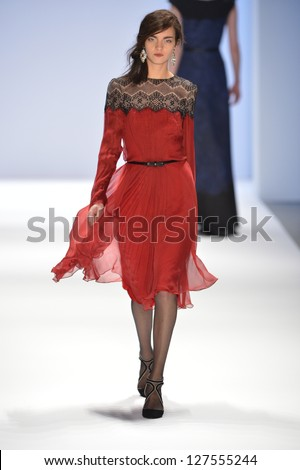 NEW YORK, NY- FEBRUARY 07: A model walks  the runway at the Tadashi Shoji  Collection for Fall/Winter 2013  during Mercedes-Benz Fashion Week on February 07, 2013 in NYC.