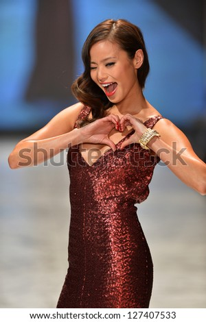 NEW YORK, NY - FEBRUARY 06: Jamie Chung wearing David Meister walks the runway at The Heart Truth's Red Dress Collection during Fall 2013 Mercedes-Benz Fashion Week on February 6, 2013, NYC.