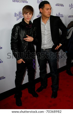 "NEW YORK, NY - FEBRUARY 02: Justin Bieber and director Jon Chu attend the ""Justin Bieber: Never Say Never"" New York movie premiere at the Regal E-Walk 13 Theater on February 2, 2011 in New York City."