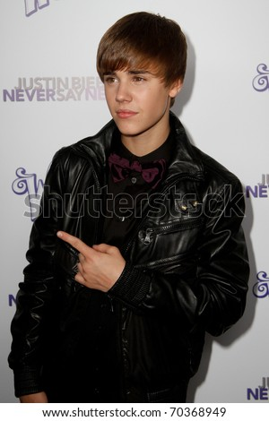 "NEW YORK, NY - FEBRUARY 02: Justin Bieber attends the ""Justin Bieber: Never Say Never"" New York movie premiere at the Regal E-Walk 13 Theater on February 2, 2011 in New York City."