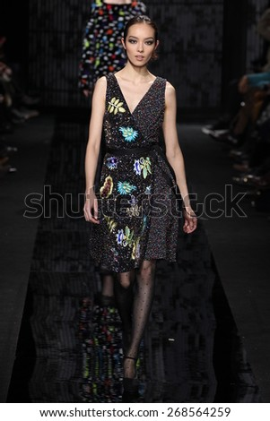 NEW YORK, NY - FEBRUARY 15: Model  Fei Fei Sun walk the runway at the Diane Von Furstenberg fashion show during MBFW Fall 2015 at Spring Studios on February 15, 2015 in NYC