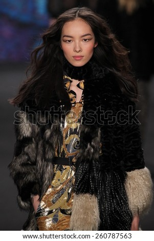 NEW YORK, NY - FEBRUARY 18: Model Fei Fei Sun walks the runway at the Anna Sui fashion show during MBFW Fall 2015 at Lincoln Center on February 18, 2015 in NYC