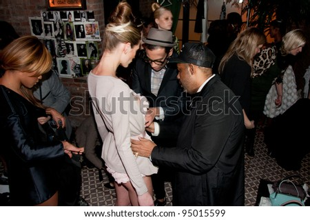 NEW YORK, NY - FEBRUARY 10: Model getting ready for Victor de Souza Fall / Winter 2012 fashion show during Mercedes-Benz Fashion Week at Bowery hotel Terrace on February 10, 2012 in NYC - stock photo