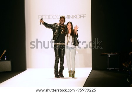 NEW YORK, NY - FEBRUARY 10: Rapper Theophilus London and designer Rebecca Minkoff walk the runway at the Rebecca Minkoff Fall 2012 fashion show during MBFW on February 10, 2012 in NYC.