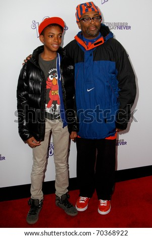 """NEW YORK, NY - FEBRUARY 02: Spike Lee and son, Jackson, attend the """"Justin Bieber: Never Say Never"""" New York movie premiere at the Regal E-Walk 13 Theater on February 2, 2011 in New York City. - stock photo"""