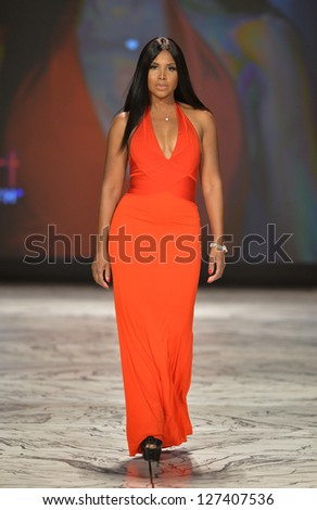 NEW YORK, NY - FEBRUARY 06: Toni Braxton wearing Herve L. Leroux walks the runway at The Heart Truth's Red Dress Collection during Fall 2013 Mercedes-Benz Fashion Week on February 6, 2013, NYC.