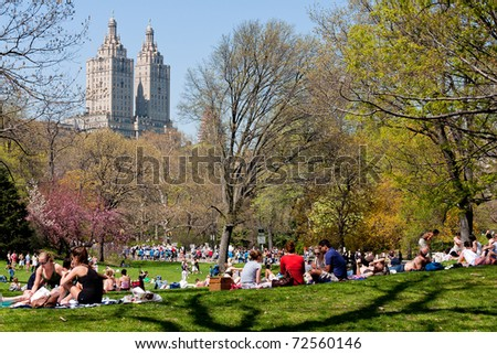 NEW YORK, NY - JUNE 15: New Yorkers relax at Central Park to enjoy the first sunbath of the season June 15, 2010 in Manhattan.