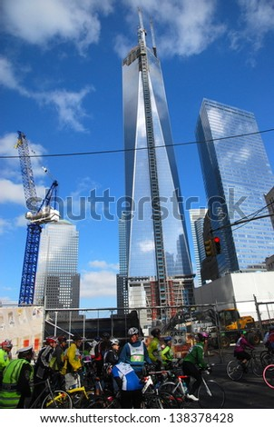 NEW YORK, NY - MAY 5: Bikers ride past the Freedom Tower in Lower Manhattan during the start of the 2013 TD 5 Boro Bike Tour on May 5th, 2013 in New York, New York.