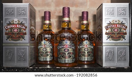 NEW YORK, NY - MAY 7, 2014: Chivas Regal box and whisky bottle on display. Chivas Regal is the market-leading scotch whisky 12 years aged and more. - stock photo