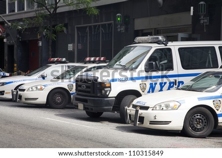 NEW YORK, NY - MAY 30: NYPD police cars parked in front of a police station in New York City on May 30, 2011.  The NYPD is one of the oldest police departments in the US established in 1845.