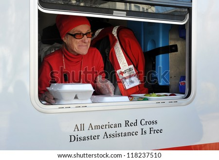 NEW YORK, NY - NOVEMBER 09:  A mobile Red Cross unit supplies hot lunches for local people in the Breezy Point part of Far Rockaway on November 9, 2012 in the Queens borough of New York City. - stock photo