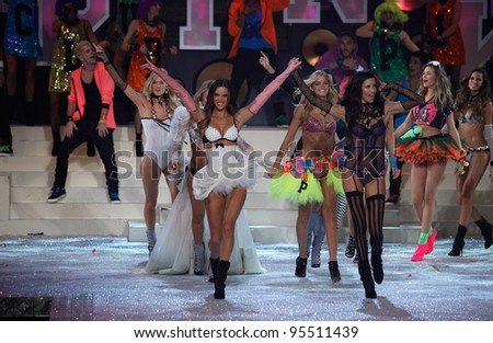 NEW YORK, NY - NOVEMBER 09: Model Alessandra Ambrosio (L) and Adriana Lima walk the runway during the 2011 Victoria's Secret Fashion Show at the Lexington Avenue Armory on November 9, 2011 in NYC.