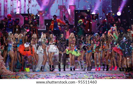 NEW YORK, NY - NOVEMBER 09: Models pose on the runway with Nicki Minaj, Kanye West and members of Maroon 5 during the 2011 Victoria's Secret Fashion Show at the  Armory on November 9, 2011 in NYC.