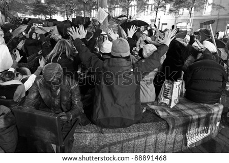 NEW YORK, NY - NOVEMBER 12: People praying at an improvised shrine on the site of the Occupy Wall Street movement in New York city. November 12, 2011