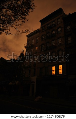 NEW YORK, NY - NOVEMBER 1: Solitary apartment lit by candlelight in the West Village during blackout caused by Hurricane Sandy on Nov 1st 2012 in New York. Many apartment dwellers have left lower Manhattan