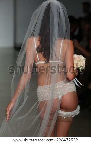 NEW YORK, NY - OCTOBER 25: A model walks runway during The Giving Bride Spring 2015 lingerie collection at the Center 548 on October 25, 2014 in New York City.
