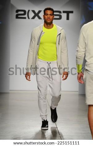 NEW YORK, NY - OCTOBER 21: A model walks the runway during 2(X)IST Men\'s Spring/Summer 2015 Runway Show on October 21, 2014 in New York City.