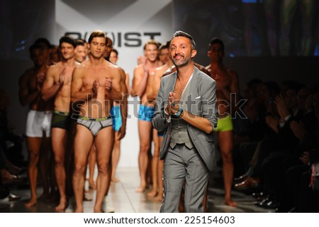 NEW YORK, NY - OCTOBER 21: 2(X)IST Creative Director Jason Scarlatti and models walk the runway during 2(X)IST Men\'s Spring/Summer 2015 Runway Show on October 21, 2014 in New York City.