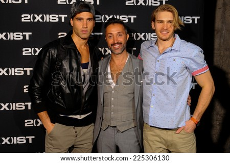 NEW YORK, NY - OCTOBER 21: 2(X)IST Creative Director Jason Scarlatti poses for a photo with models backstage during 2(X)IST Spring/Summer 2015 Runway Show on October 21, 2014 in New York City.