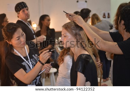 NEW YORK, NY - SEPTEMBER 11: A model getting ready backstage at the Edun Spring 2012 fashion show during Mercedes-Benz Fashion Week on September 11, 2011 in New York City - stock photo