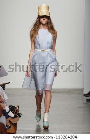NEW YORK, NY - SEPTEMBER 10: A model walks the runway at the Karen Walker Spring Summer 2013 fashion show during Mercedes-Benz Fashion Week on September 10, 2012 in New York City, USA