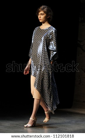 NEW YORK, NY - SEPTEMBER 5: A model walks the runway at the Tia CIbani debut Spring Summer 2013 fashion show during Mercedes-Benz Fashion Week on September 5, 2012 in New York City, USA