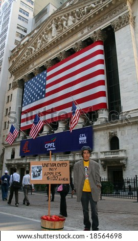 NEW YORK, NY -- SEPTEMBER 30, 2008: An boy pretends to sell apples outside the New York Stock Exchange on September 30, 2008, the day after the record-breaking 777-point drop in the Dow