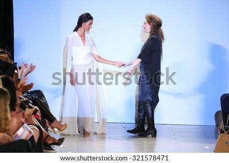 NEW YORK, NY - SEPTEMBER 13: Designer Andrea Wild and model walk Wild runway at the FTL Moda Spring 2016 during NYFW at Vanderbilt Hall  on September 13, 2015 in NYC.